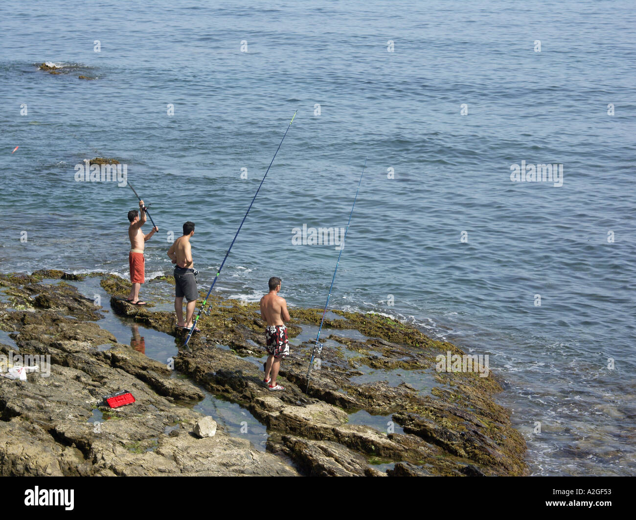 Young people fishing from the rocks el faro mijas costa for Videos of people fishing