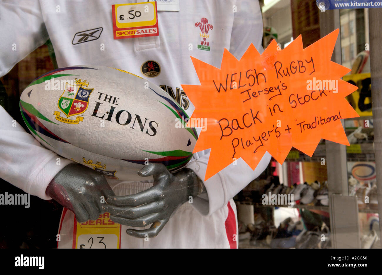 Rugby display in sports shop window in Cardiff city centre South Wales UK - Stock Image
