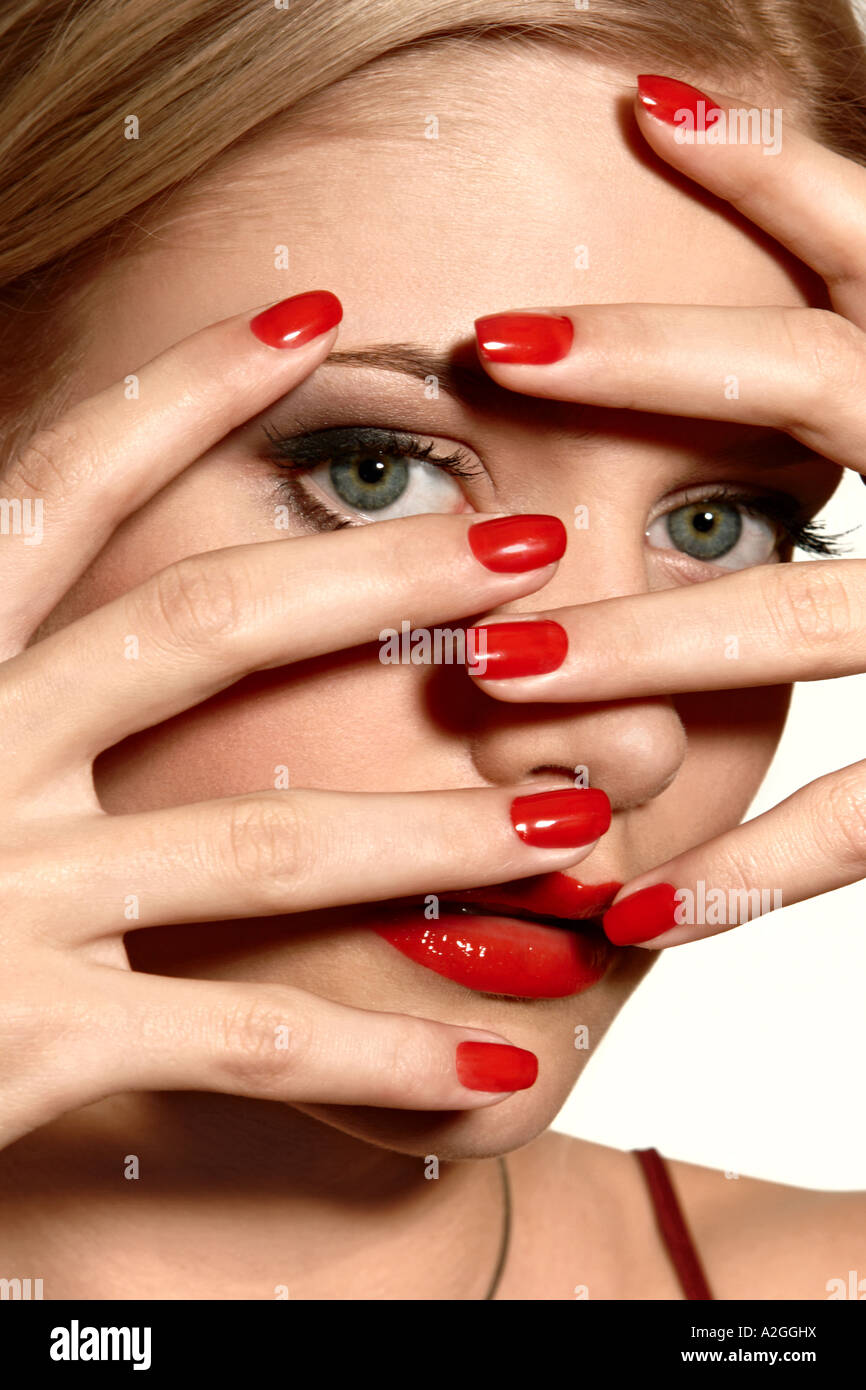 1217507 indoor studio young woman 25 30 blonde hand hands cover face ...