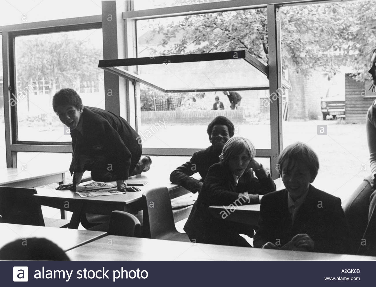 Secondary school children creating chaos in the classroom - Stock Image