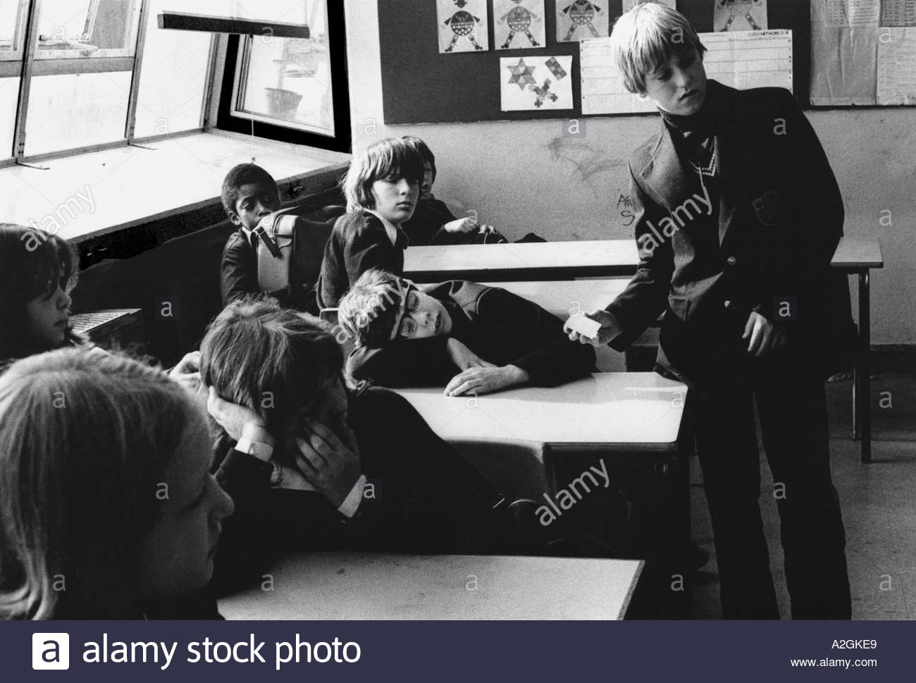 Secondary school children creating chaos disrupting the classroom Stock Photo