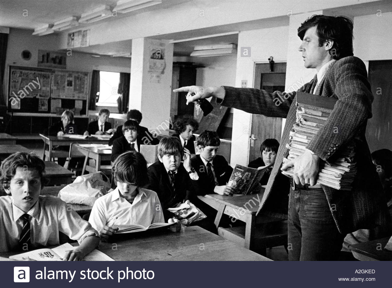 Secondary school teacher trying to control the classroom - Stock Image