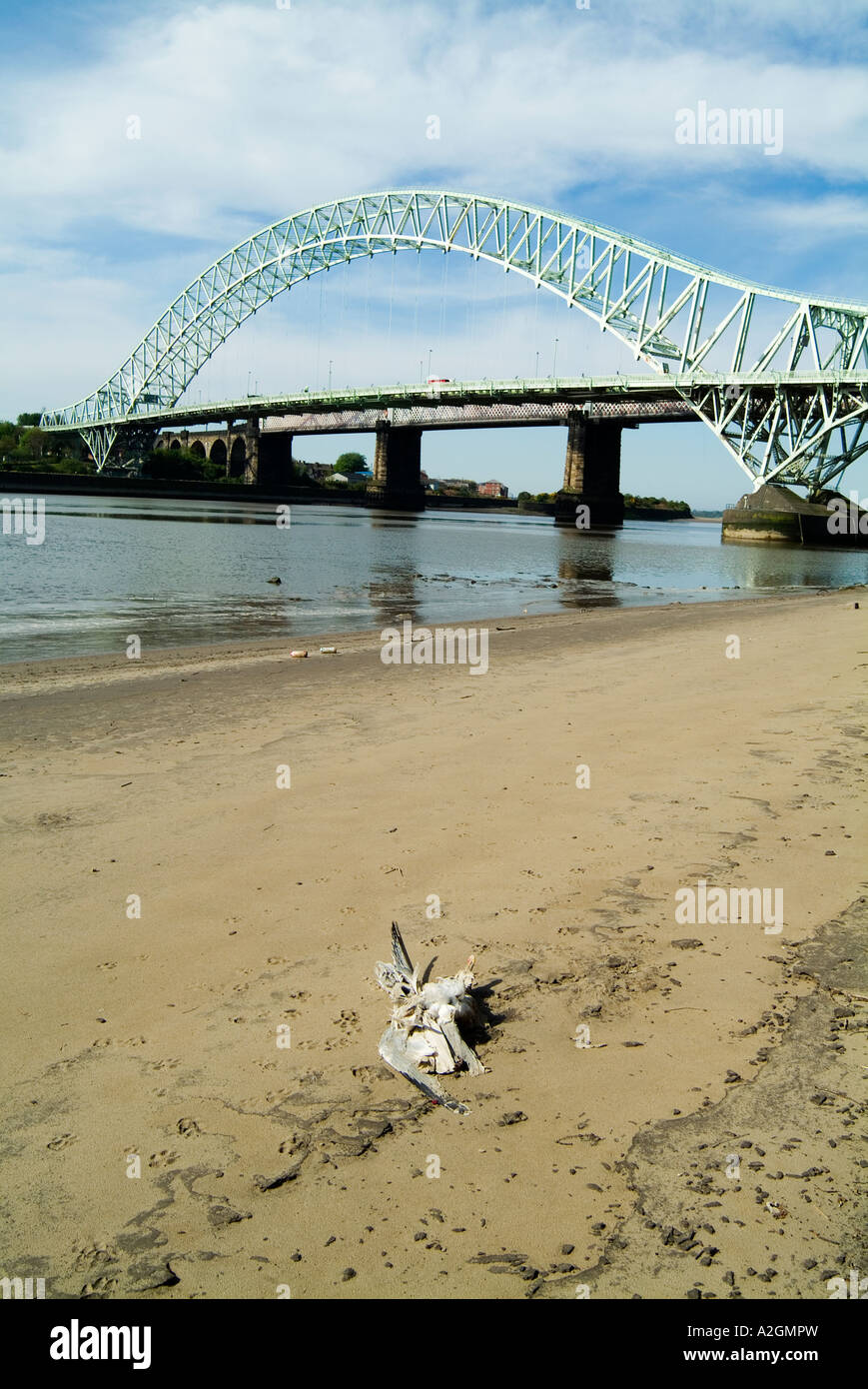 Runcorn Widnes Bridge spanning the River Mersey in Cheshire with debris in the foreground. - Stock Image