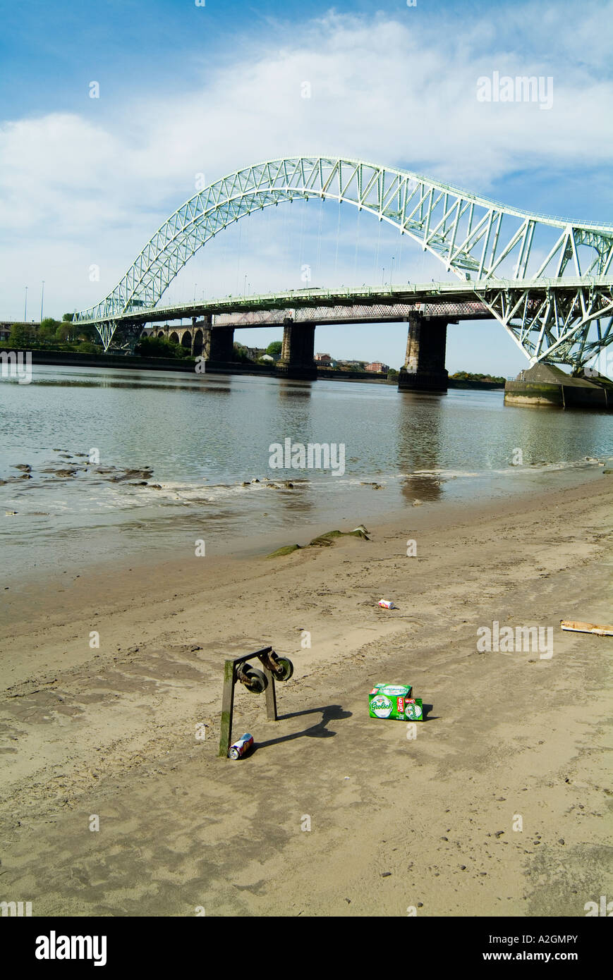 Runcorn Widnes Bridge spanning the River Mersey in Cheshire with debris in the foreground. Stock Photo