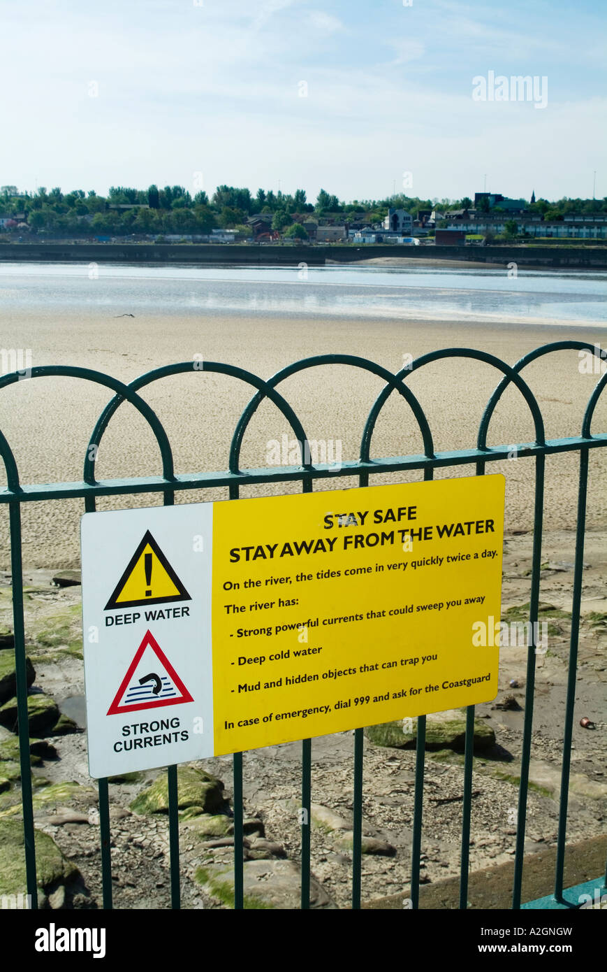 Stay safe stay away from the water sign on the banks of the River Mersey in West Bank Widnes Cheshire. UK. - Stock Image