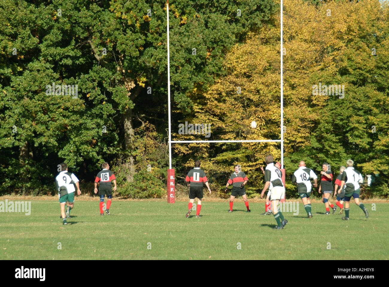 Autumn backdrop to action around goal posts in adult team game of amateur  rugby in a match played at local sport park Brentwood Essex England UK