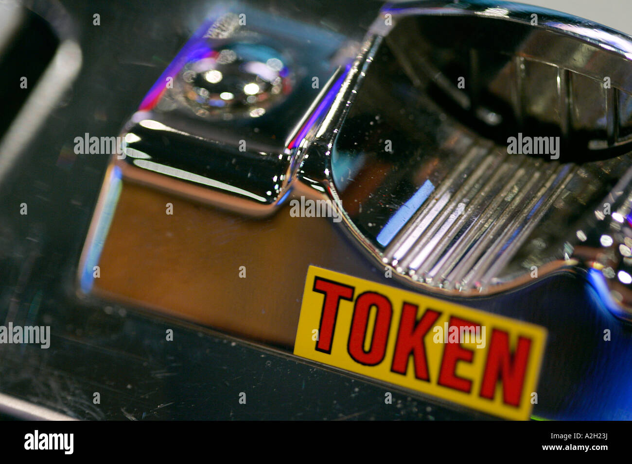 Close up of a slot machine button banknote coin token note casino