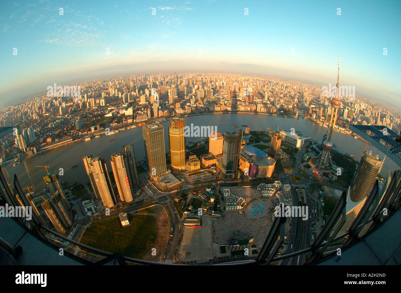 View of Shanghai in China from the Jin Mao tower at sunrise with a fisheye - Stock Image