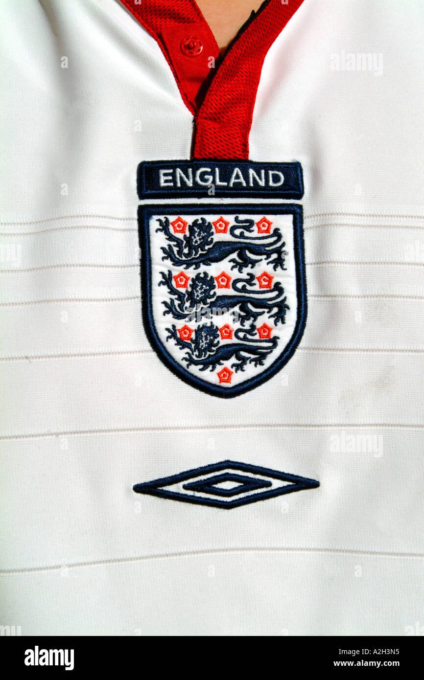 9aca6d732 england replica football shirt national team soccer sport close up detail  red white blue badge three
