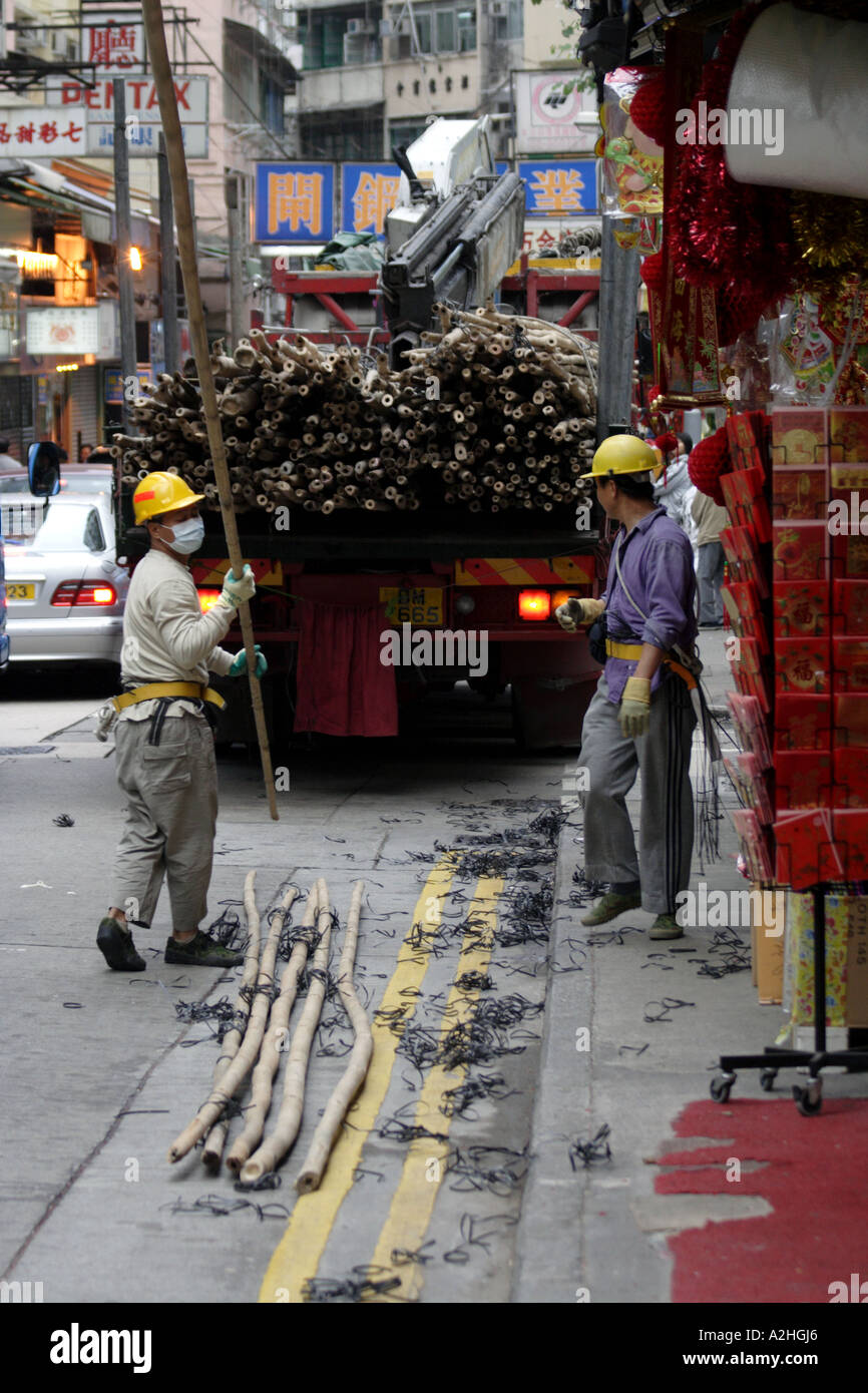 Construction men and bamboo scaffolding, Wan Chai, Hong Kong SAR - Stock Image