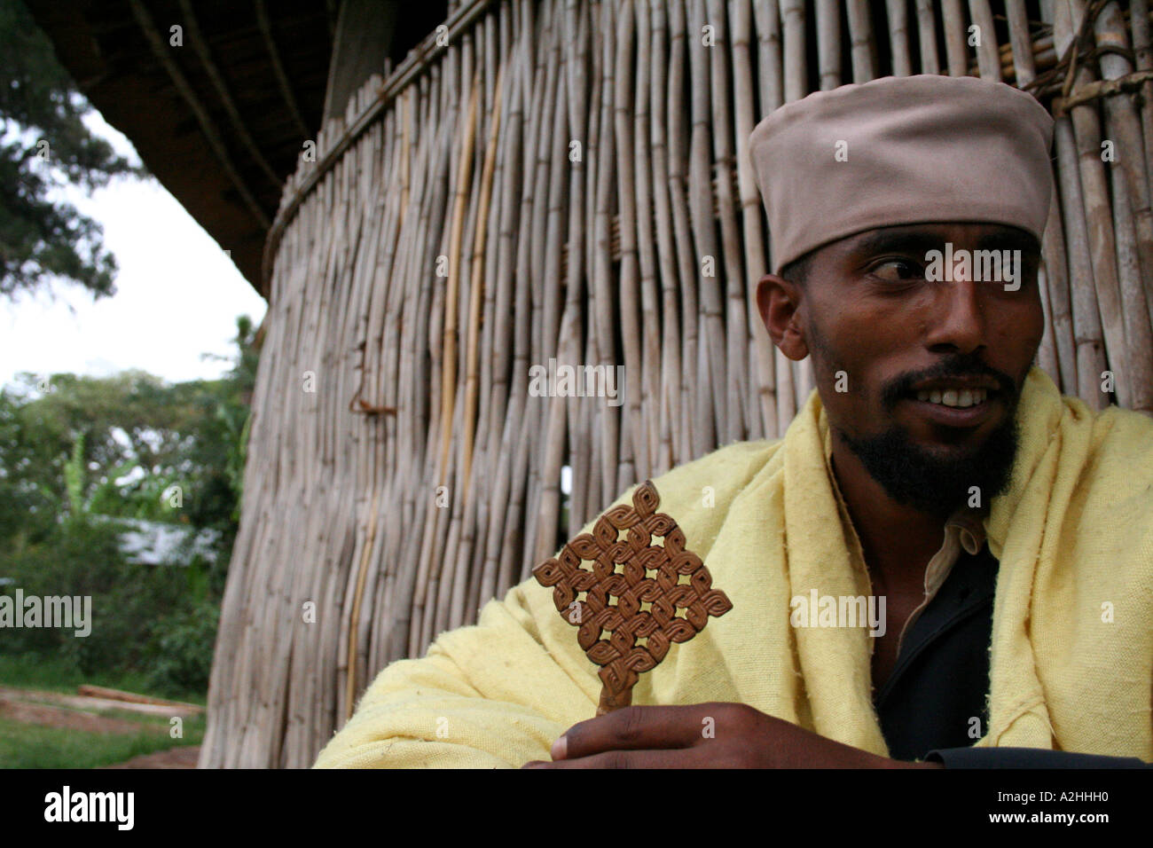 A priest sits outside Ura Kidane Meret, one of the island   Monasteries in Lake Tana, Bahar Dar, Ethiopia - Stock Image