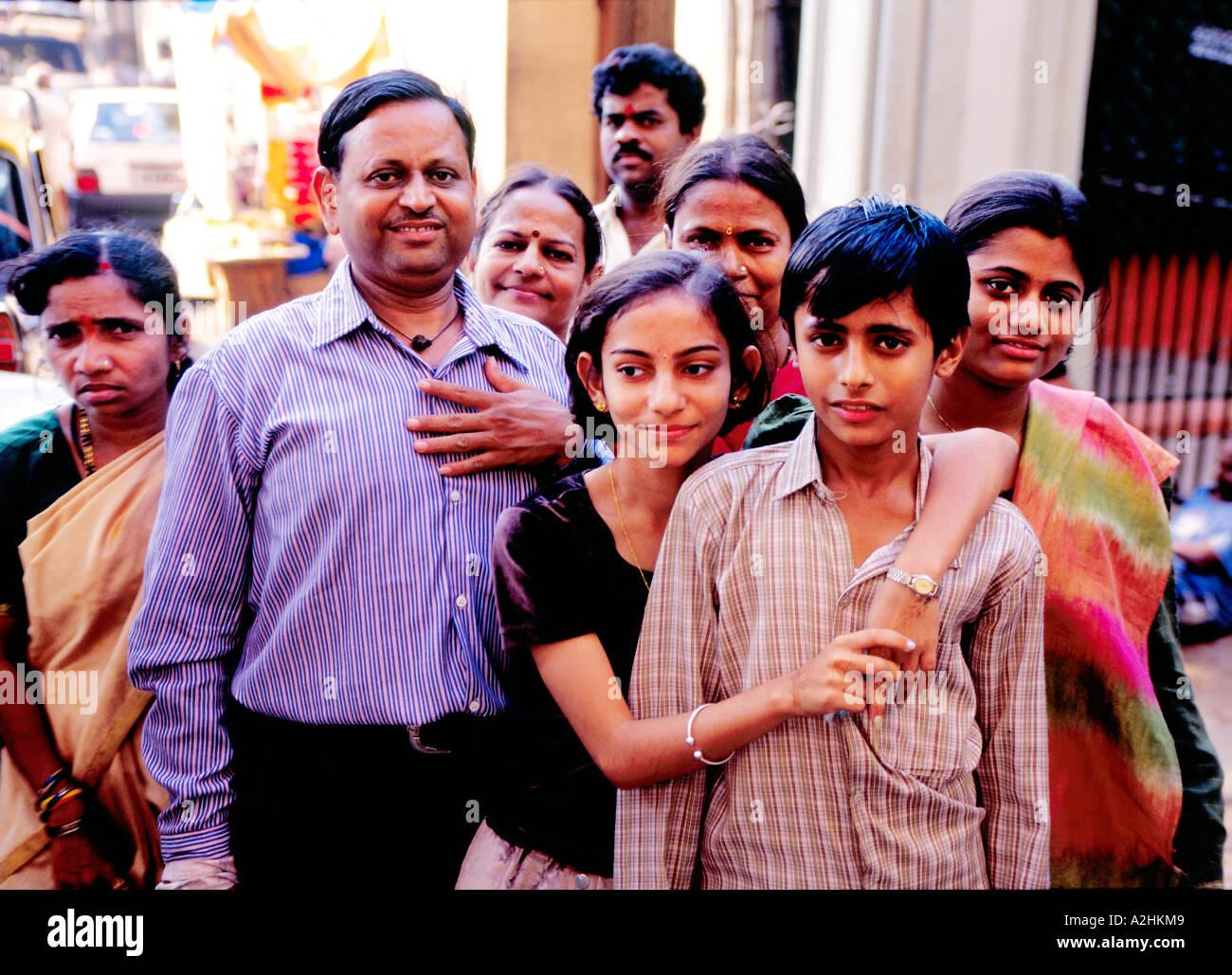 Extended Hindu Family including a servant after puja (ritual worship) posing at courtyard of Mahalaximi temple. Mumbai, India - Stock Image