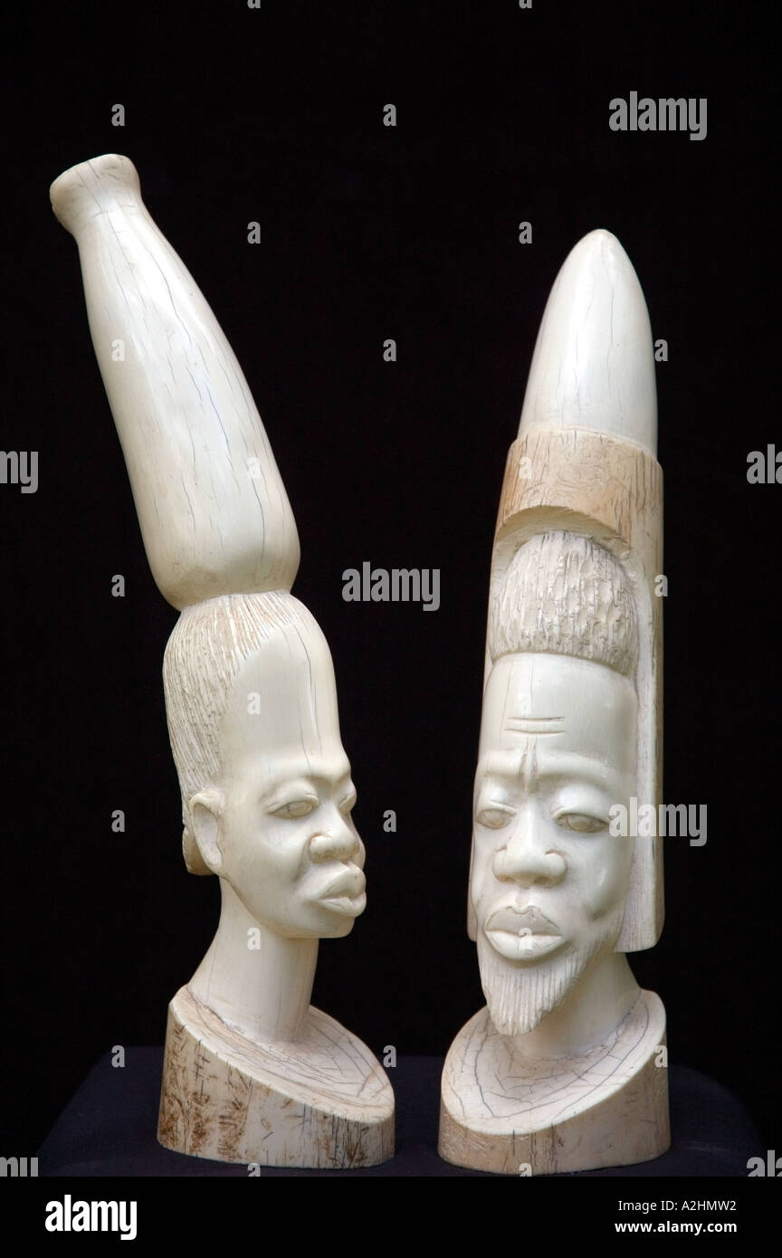 Carved ivory figurines of a stylised African man and woman. DSC_8190 - Stock Image