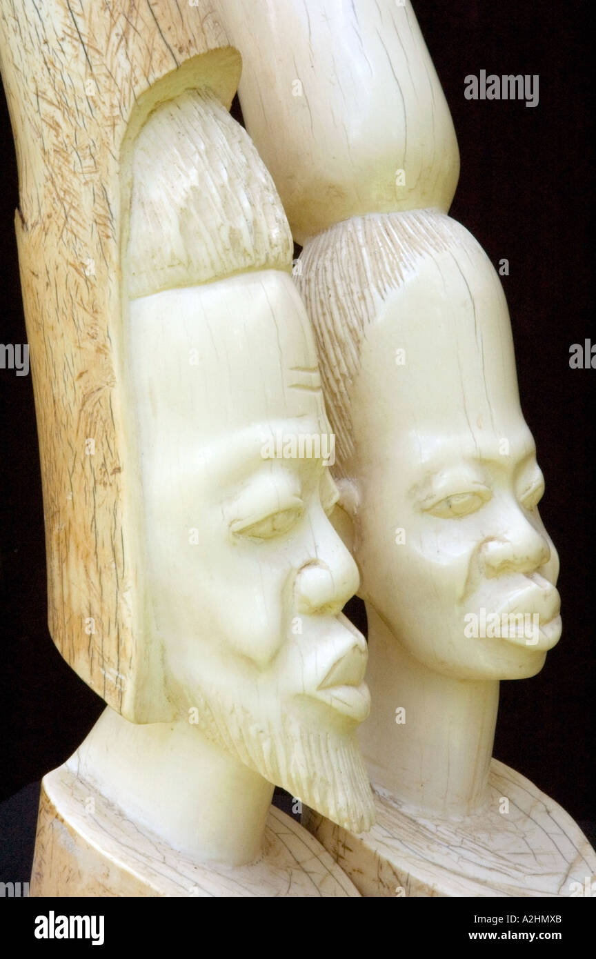 Carved ivory figurines of a stylised African man and woman. DSC 8197 Stock Photo