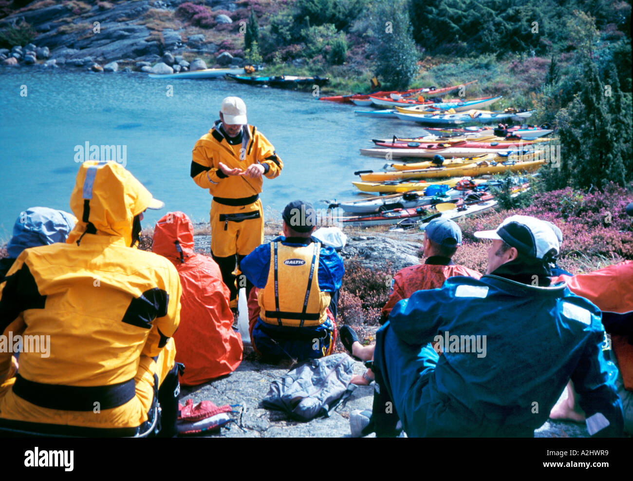 Group of sea kayakers having a theory class during a course in advanced paddling techniques Orust Island Bohusland Stock Photo