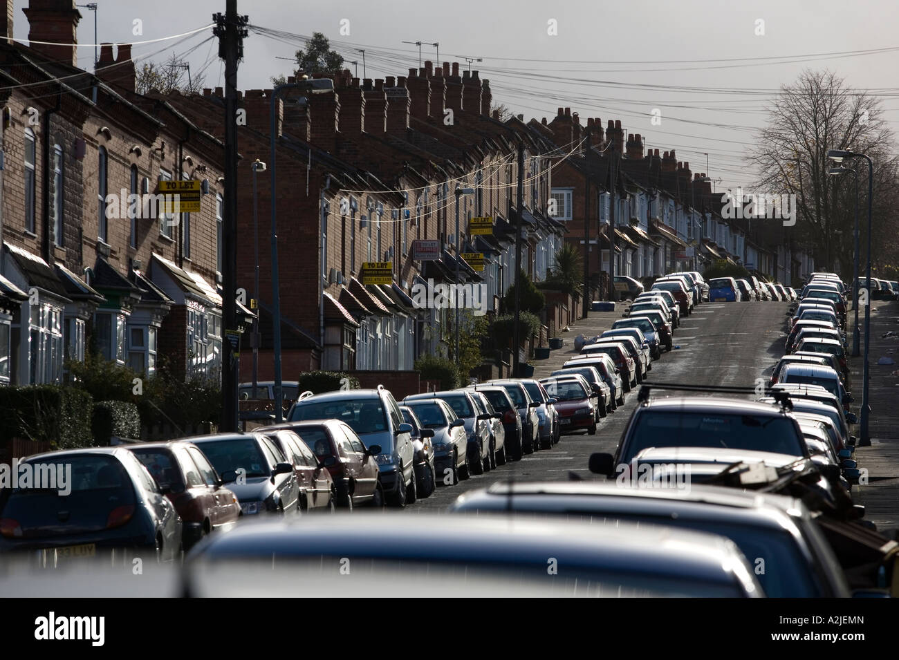 Rows of parked cars line Alton Road in inner city Birmingham West Midlands England UK The area is mainly student - Stock Image