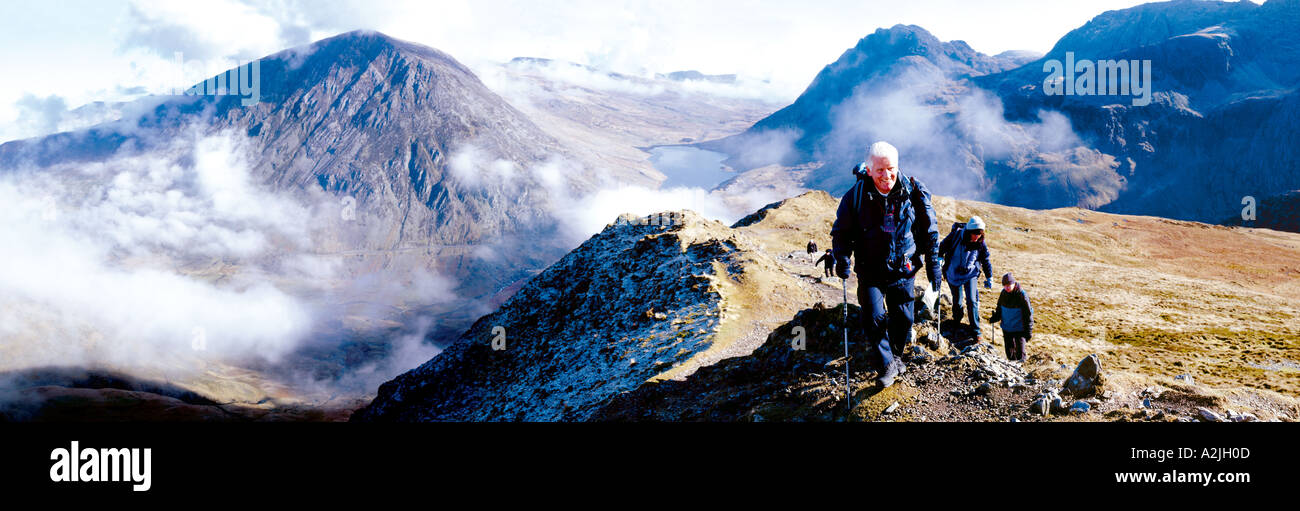 A group of old people,white, European over 60 walking,trekking,rambling through the mountains,hills. - Stock Image