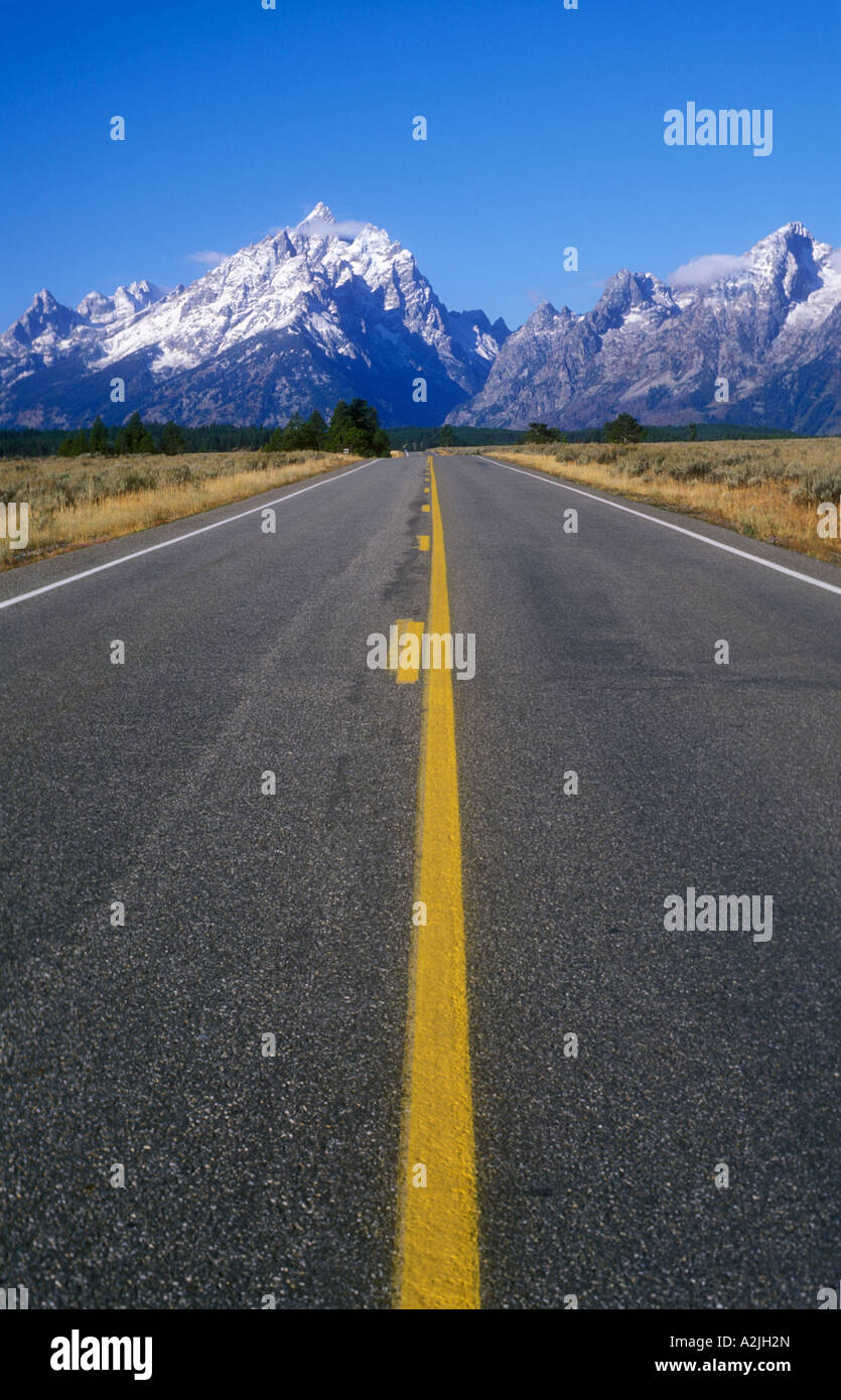 USA Wyoming Grand Tetons National Park road leading to mountains - Stock Image