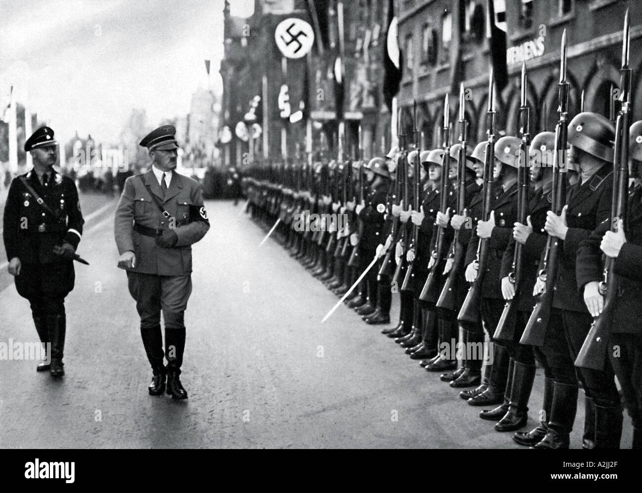 ADOLF HITLER and Heinrich Himmler review a parade of Hitler s personal guard - Stock Image