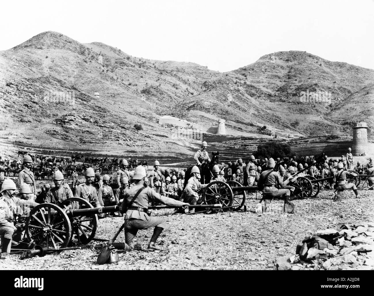 British Army field artillery in front of a hill fort in the Punjab India about 1890 Note cavalry at left of picture - Stock Image