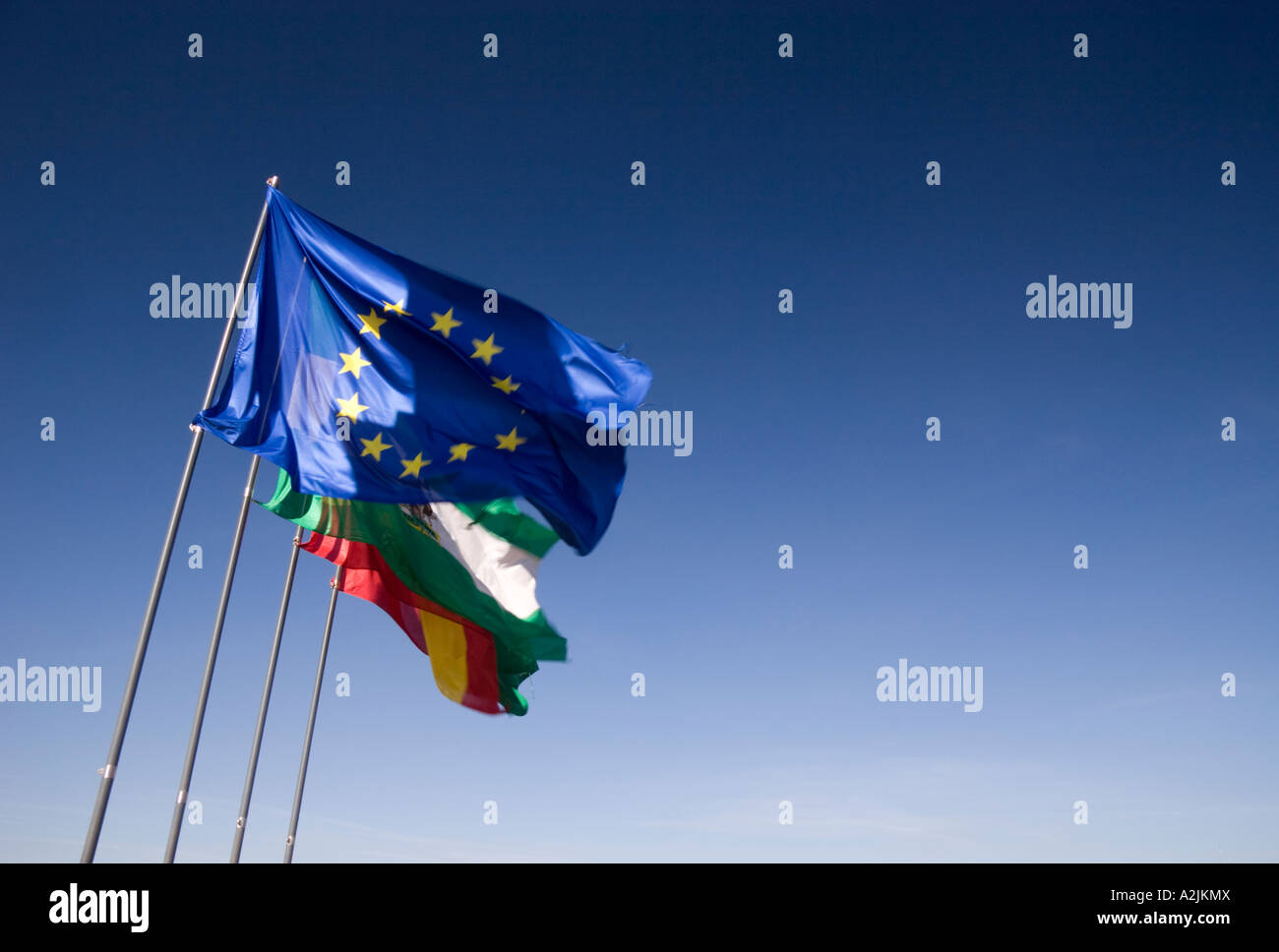 European Union flag, Andalucian flag and the Spanish flag fly from the Alhambra tower, Granada, Andalucia, Spain - Stock Image