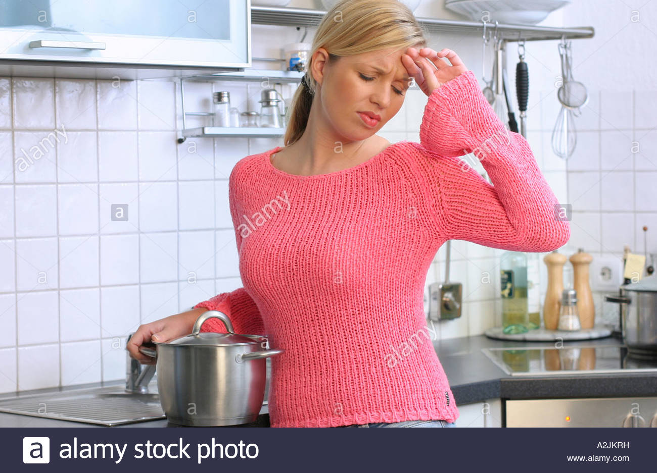 woman works in kitchen Stock Photo