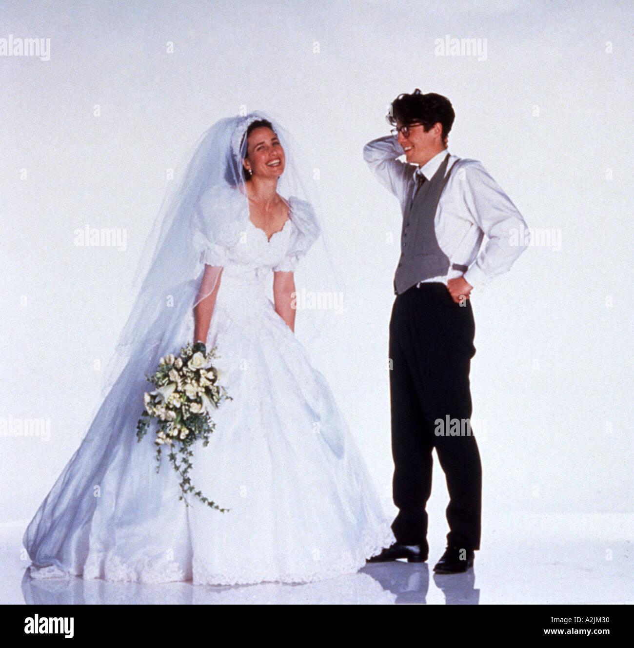 FOUR WEDDINGS AND A FUNERAL 1994 Polygram film starring Andie  MacDowell and Hugh Grant - Stock Image