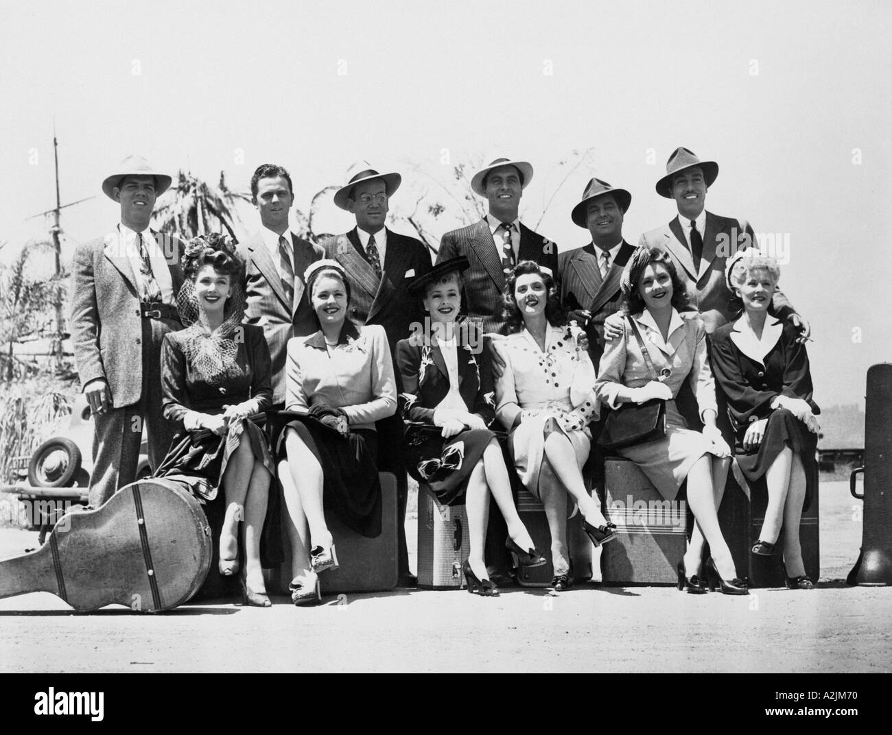 GLENN MILLER BAND Glenn Miller 3rds from left back row with members of his band and their wives on tour in the late 1930s - Stock Image