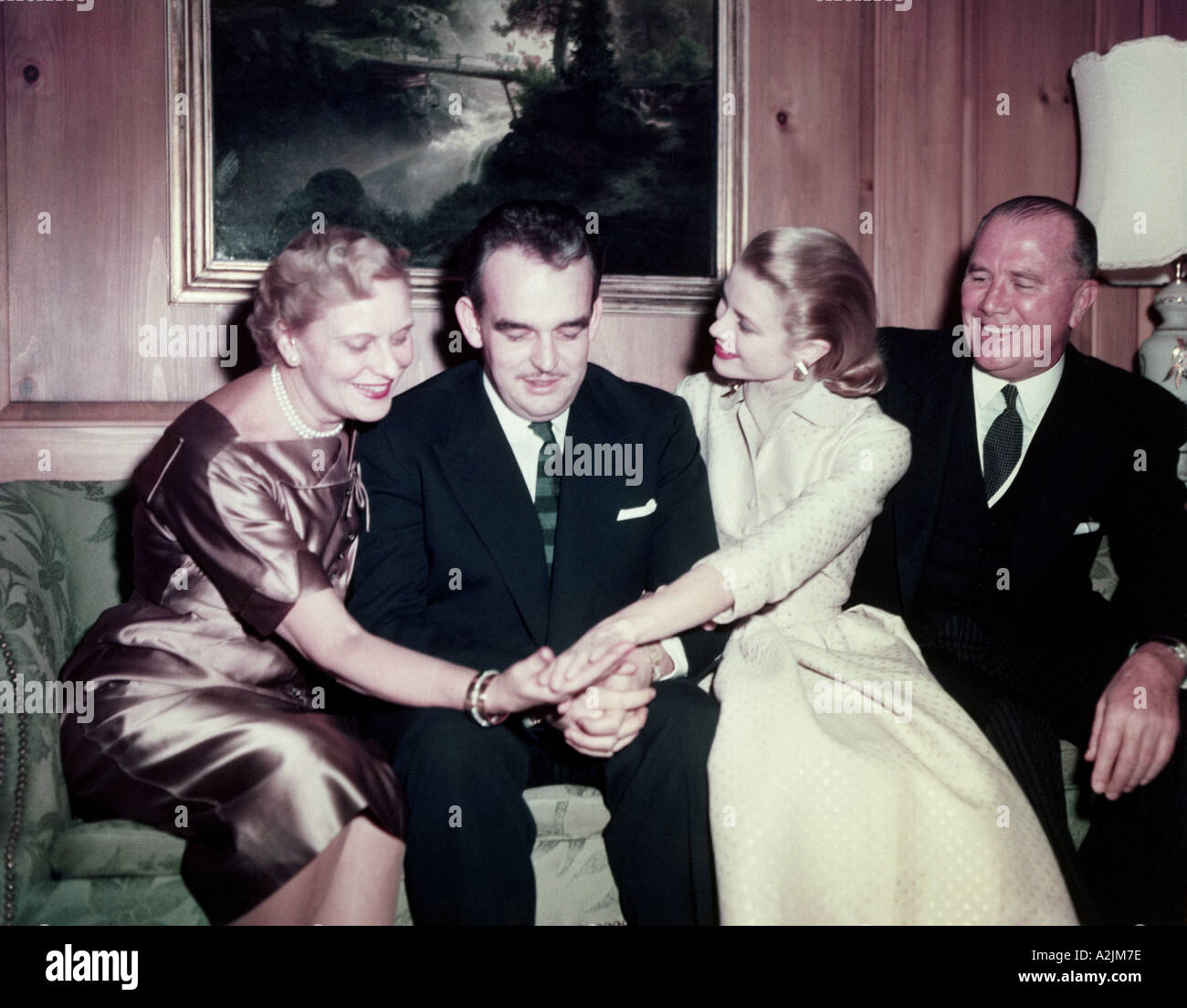 GRACE KELLY shows her engagement ring from Prince Ranier to her parents - Stock Image