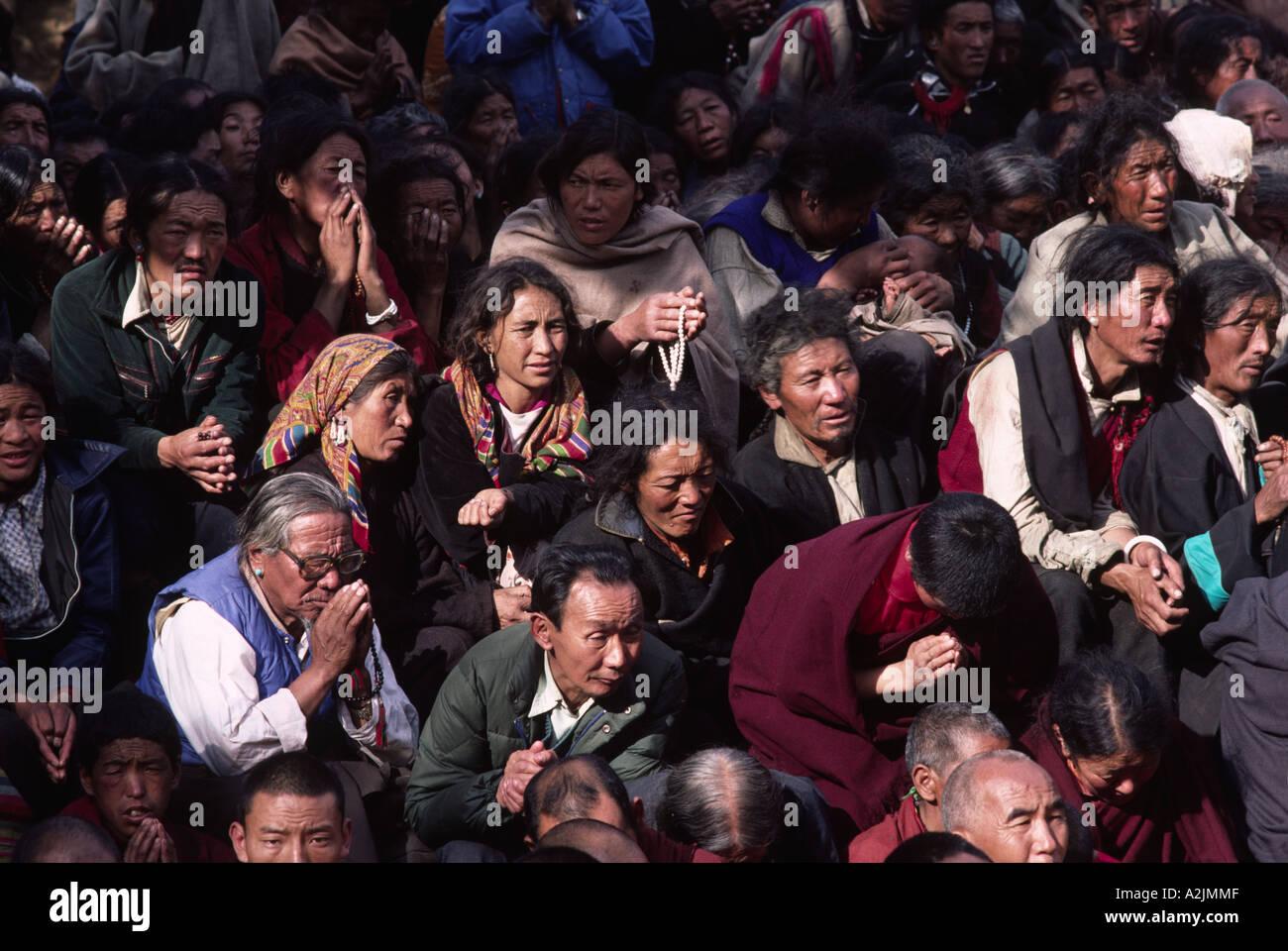 Pilgrims from the Himalaya listening to the Dalai Lama. India - Stock Image