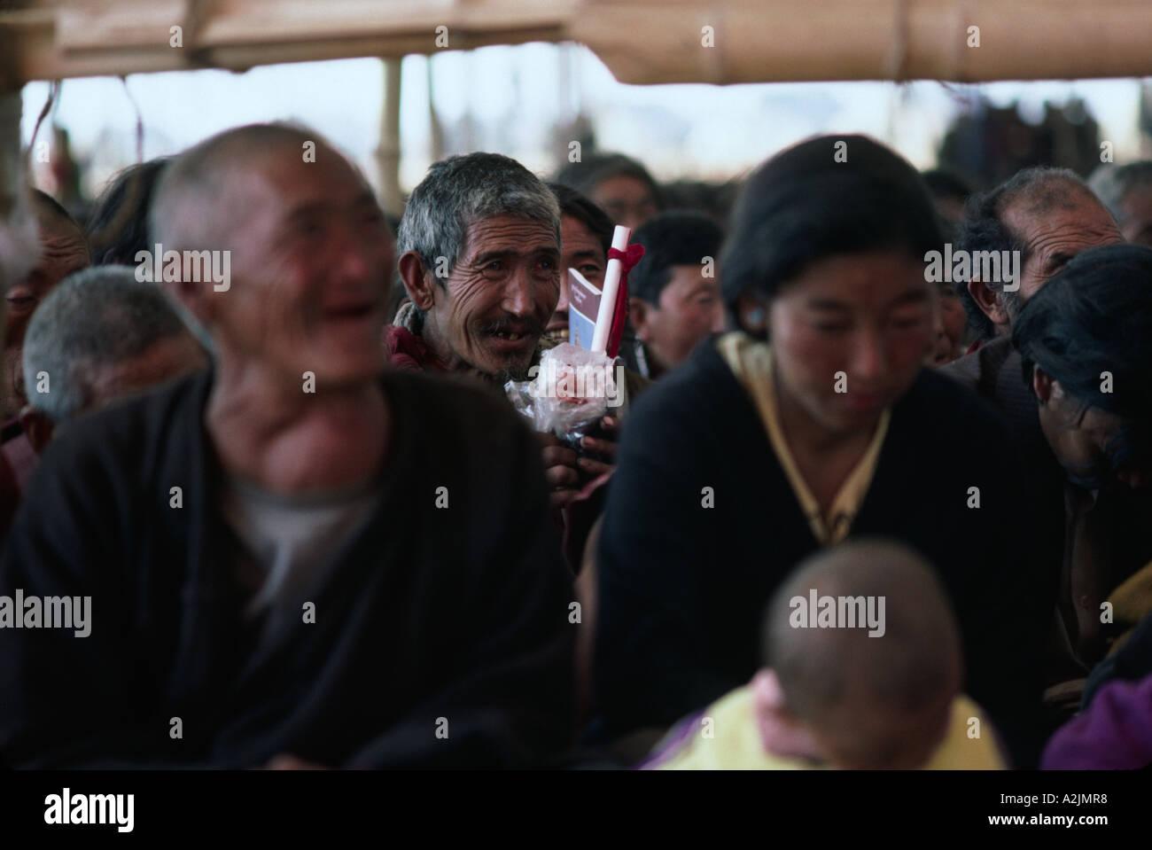 Pilgrims listening with awe to the teachings of the Dalai Lama. India - Stock Image