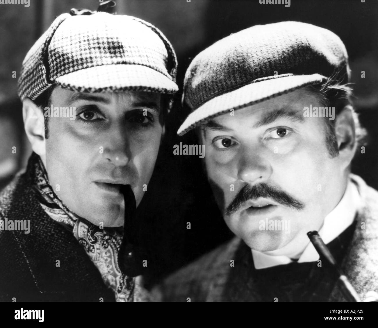 SHERLOCK HOLMES 1944 film with Nigel Bruce at left as Holmes and Basil Rathbone as Dr Watson - Stock Image