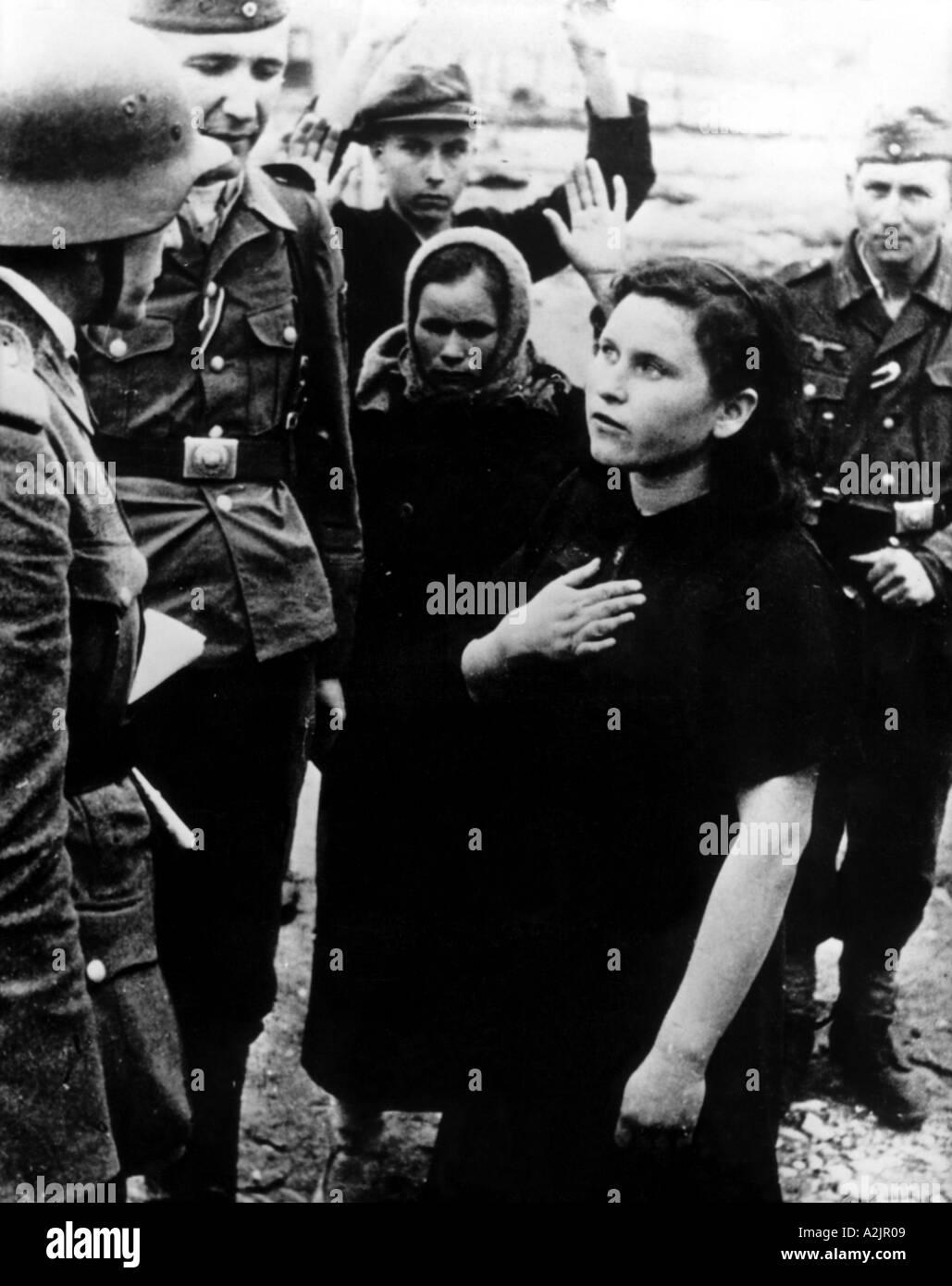 WW2 German troops question a Russian woman - Stock Image