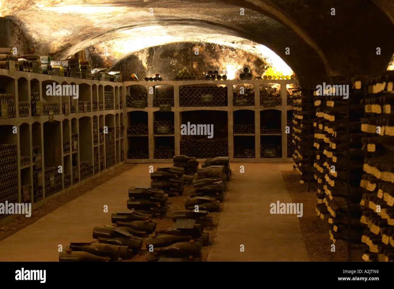 In the underground wine cellar piles of thousands of bottles in the treasure chamber where the oldest bottles are kept Burgundy wine on a gravelly pebbly ... & In the underground wine cellar: piles of thousands of bottles in the ...