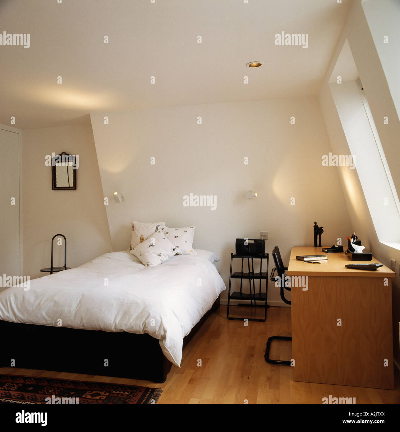 Modern White Attic Bedroom With Desk And Wooden Floor Stock Photo Alamy