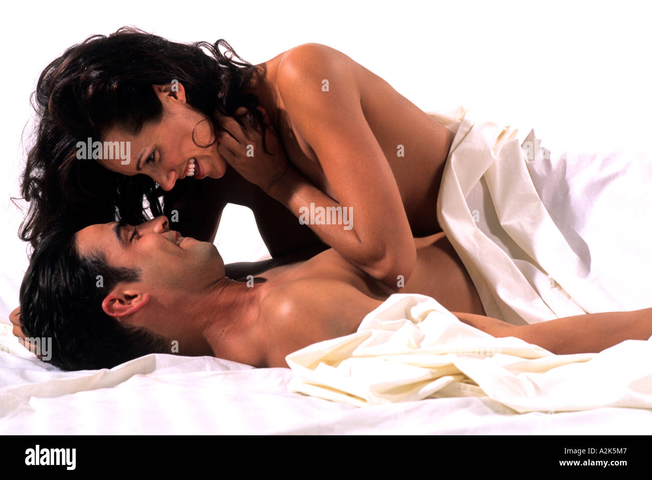 Sexy Couple In Bed Romance Under Sheets Snuggling Stock -9849