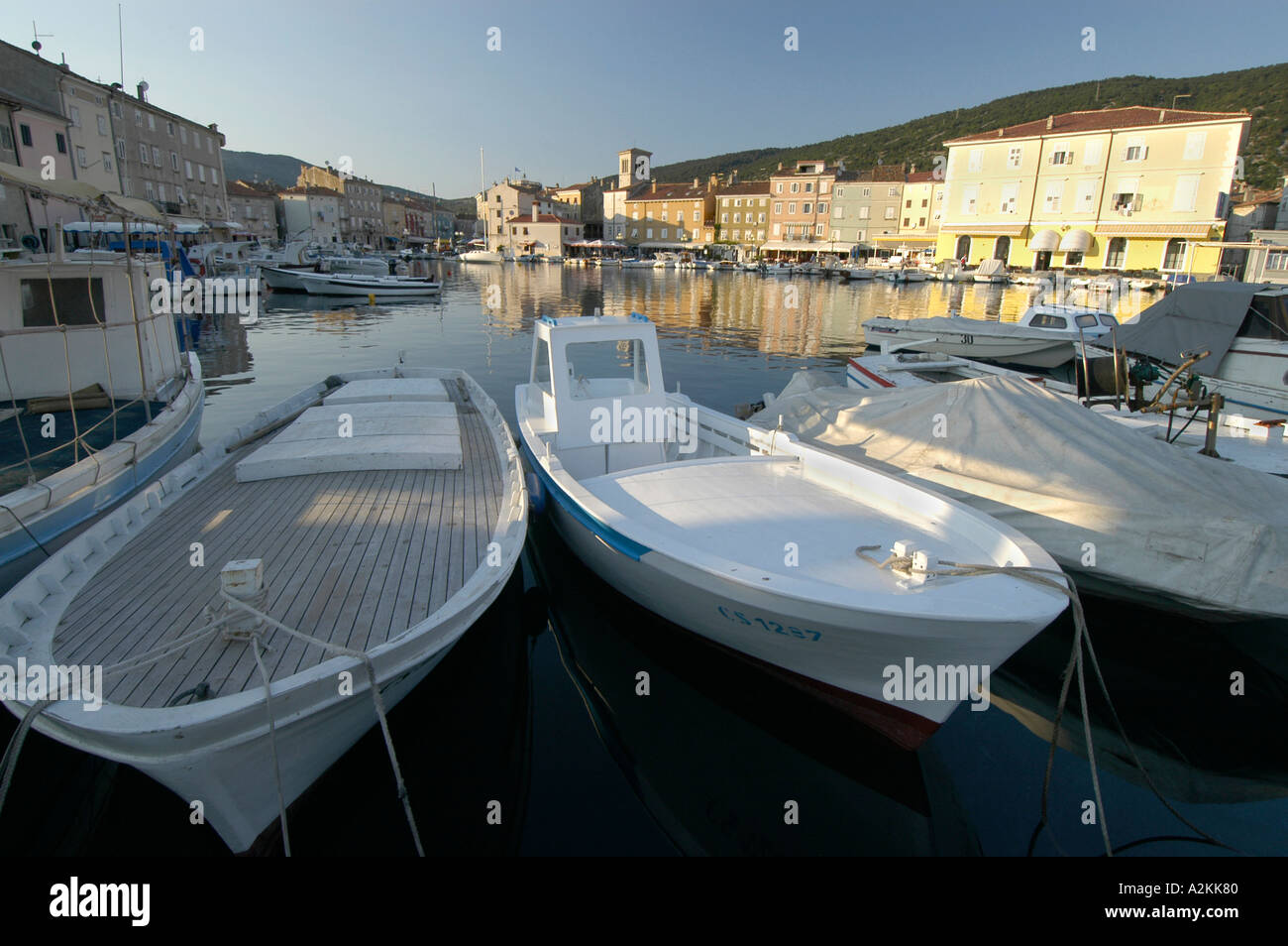 fishingboats in the harbor of the historic center of Cres Stock Photo
