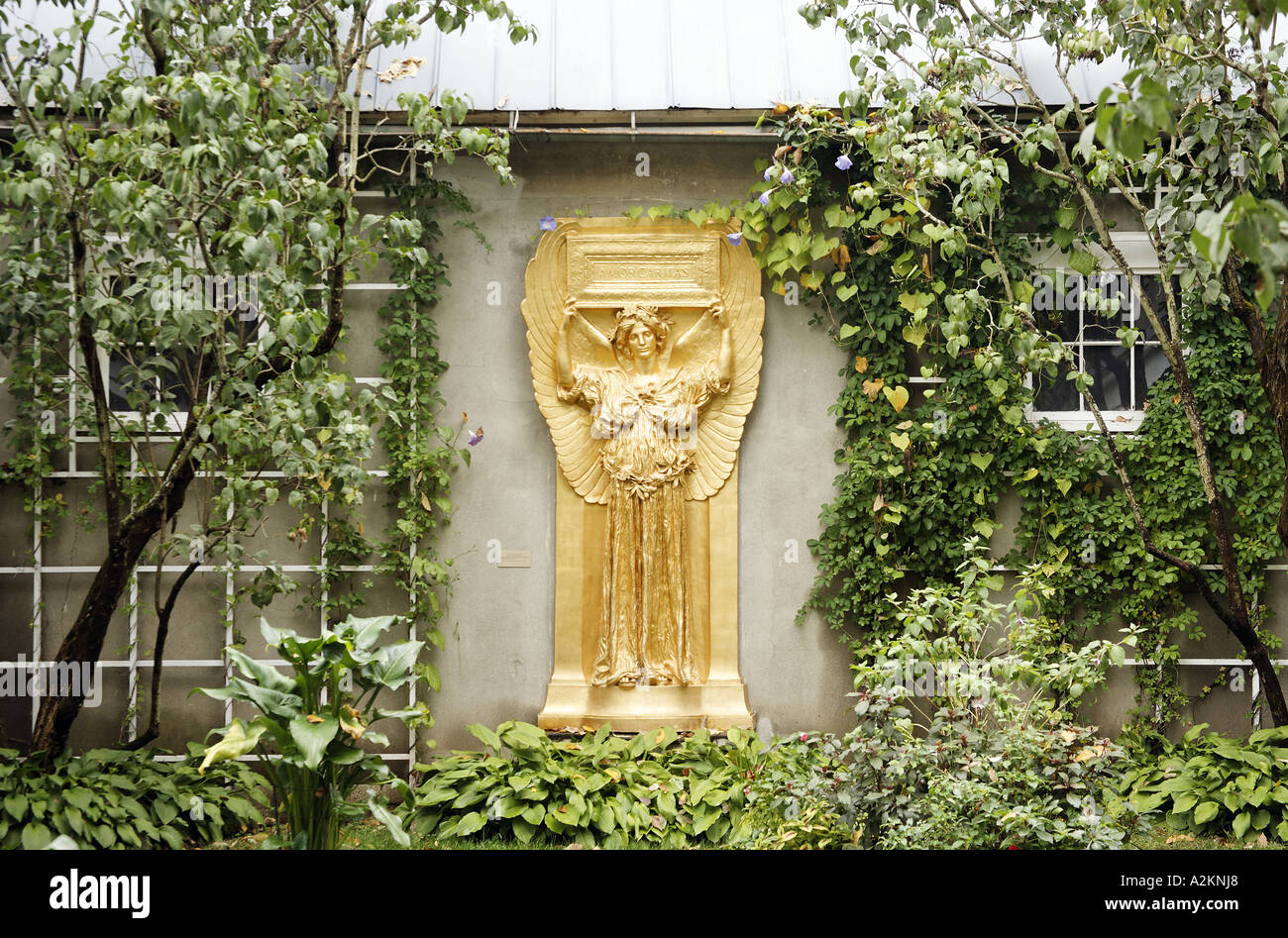 Golden relief of female angel in garden setting New Gallery atrium Saint Gaudens National Historic Site Cornish New Hampshire - Stock Image