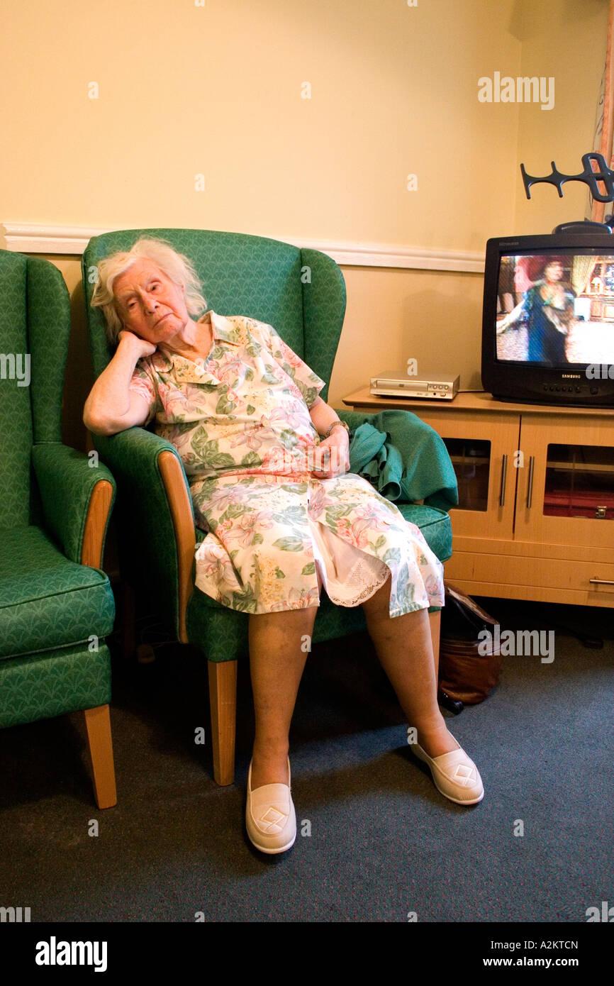 Old Lady In Her Nineties Asleep In Armchair In Nursing