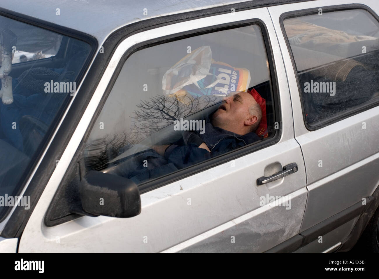 Sleeping In Car >> Man Sleeping In Car In A Rest Area Along The Autobahn In Germany