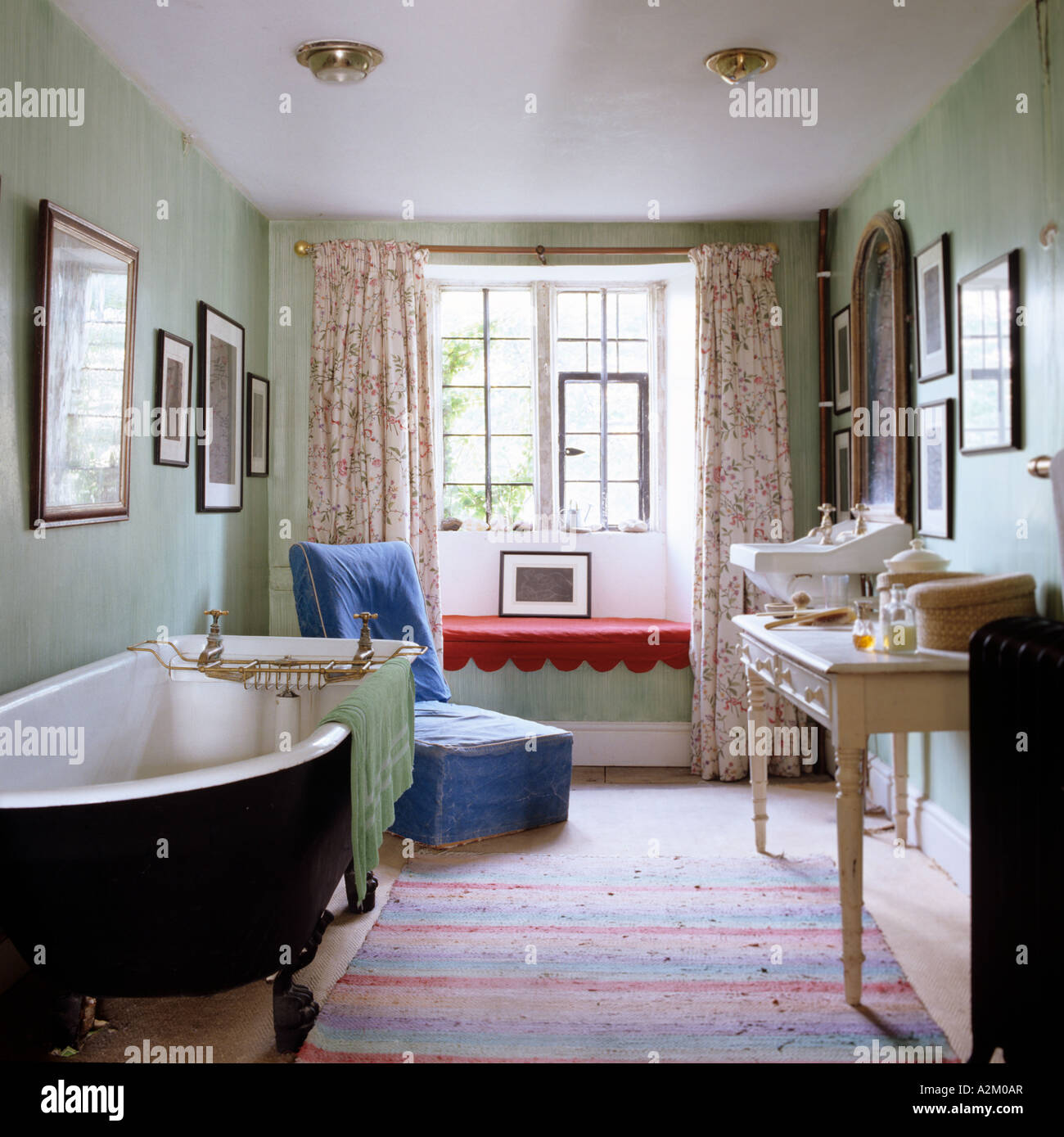 Bathroom with freestanding bathtub, dressing table and old fashioned ...
