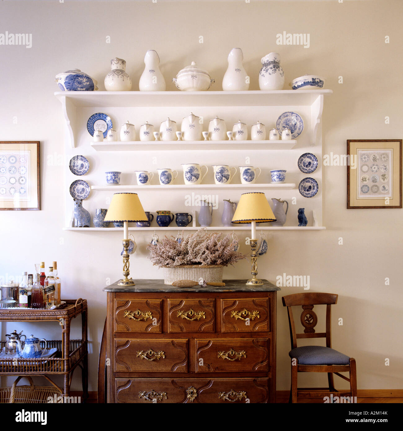 blue and white china displayed on a shelf in a traditional ...