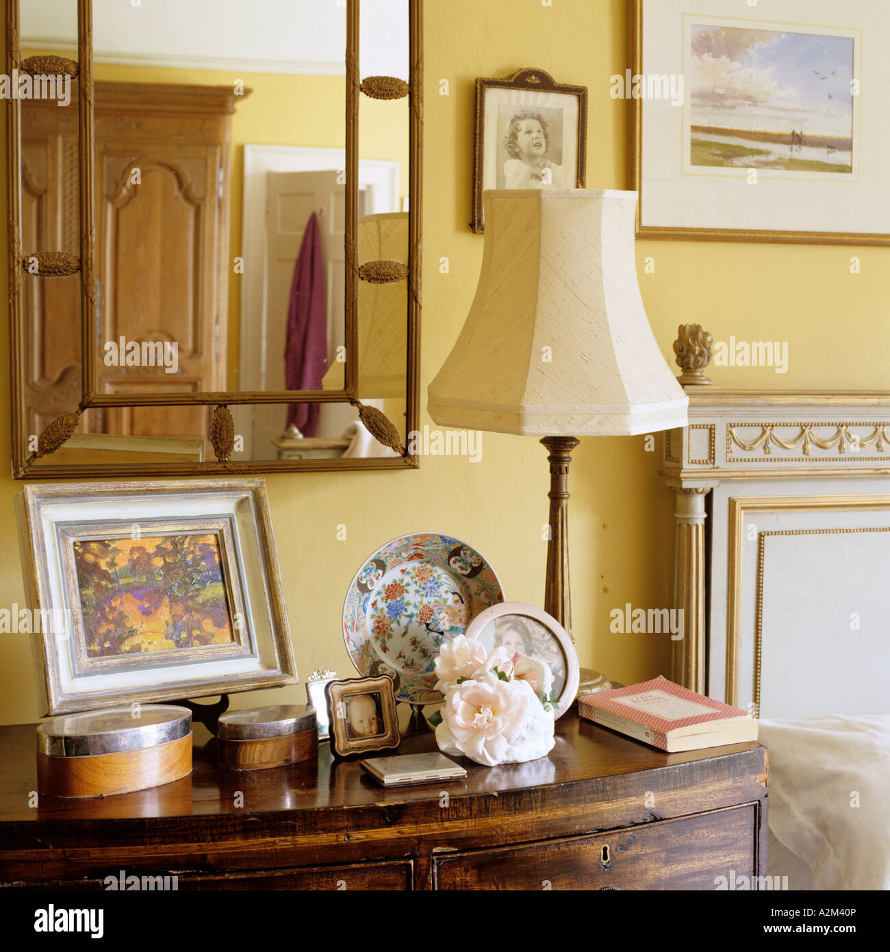 Picture of: Mirror Above Bedside Table With Lamp And Ornamental Display Stock Photo Alamy