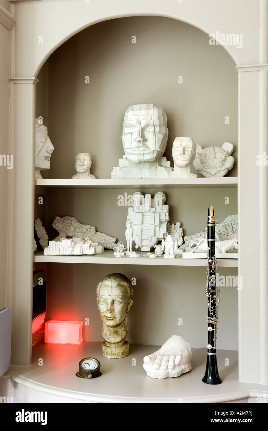 Recessed shelving with an assortment of sci-fi objects and sculptures - Stock Image