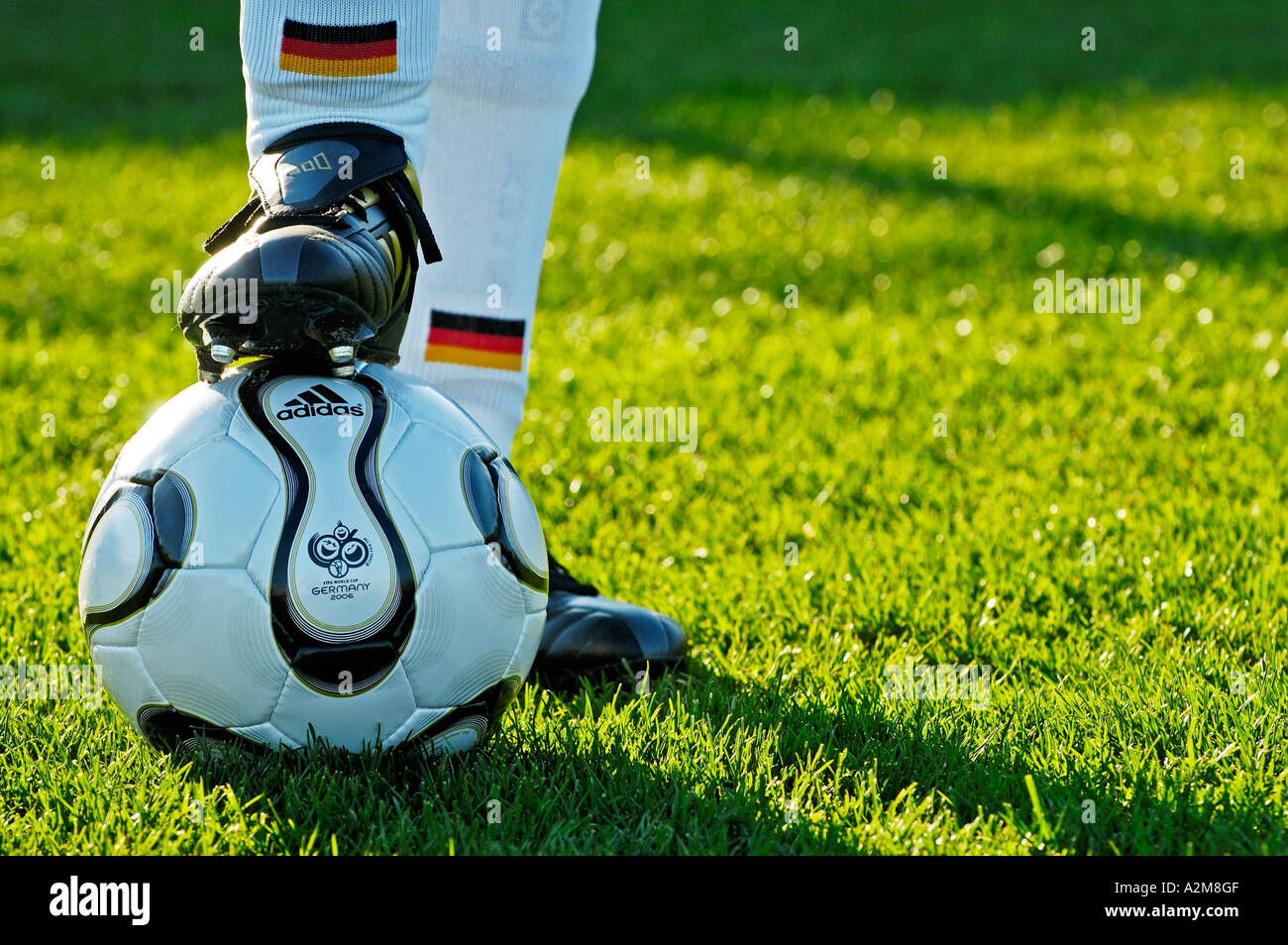 the legs of a german national soccer player and the official