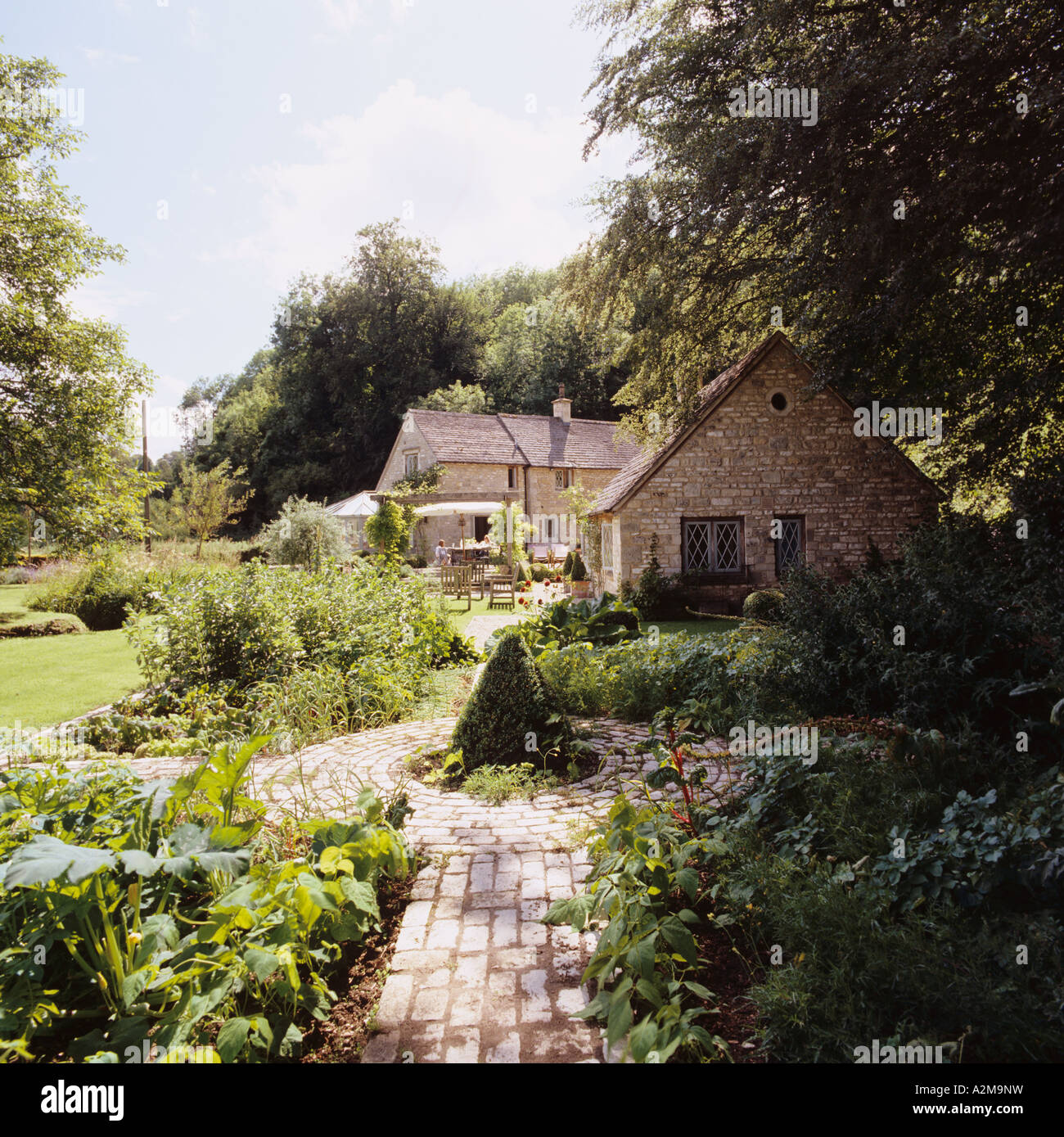 Cottage exterior in country garden with path - Stock Image