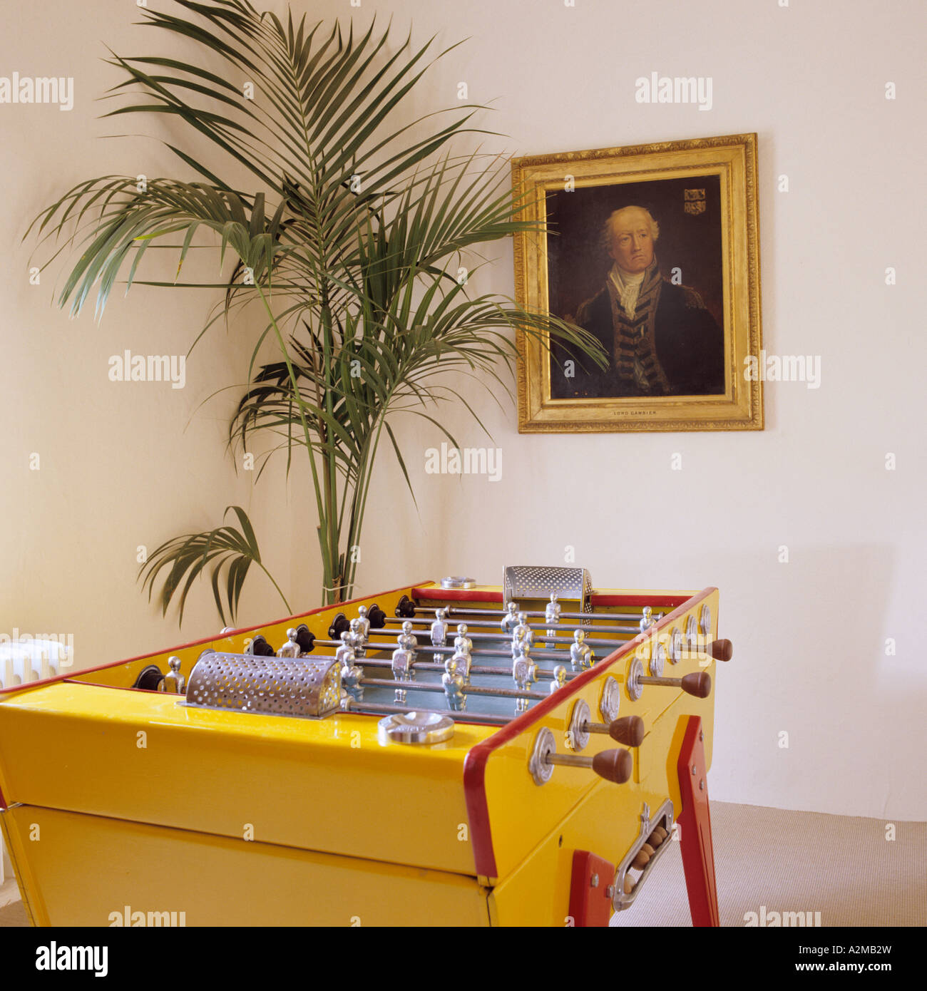 Table football, indoor palm and artwork - Stock Image
