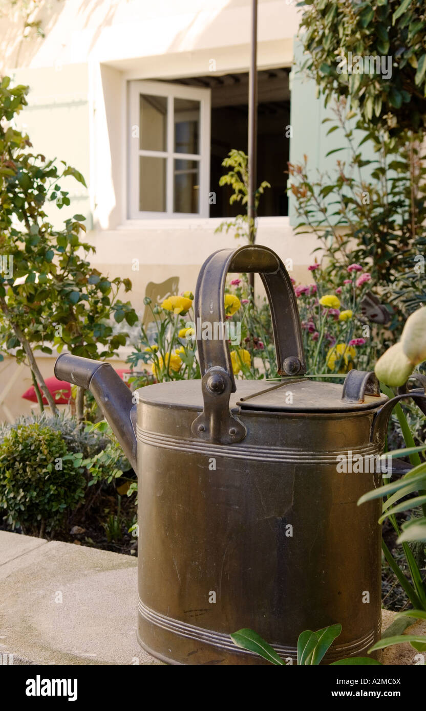 Watering Can On Garden Wall   Stock Image