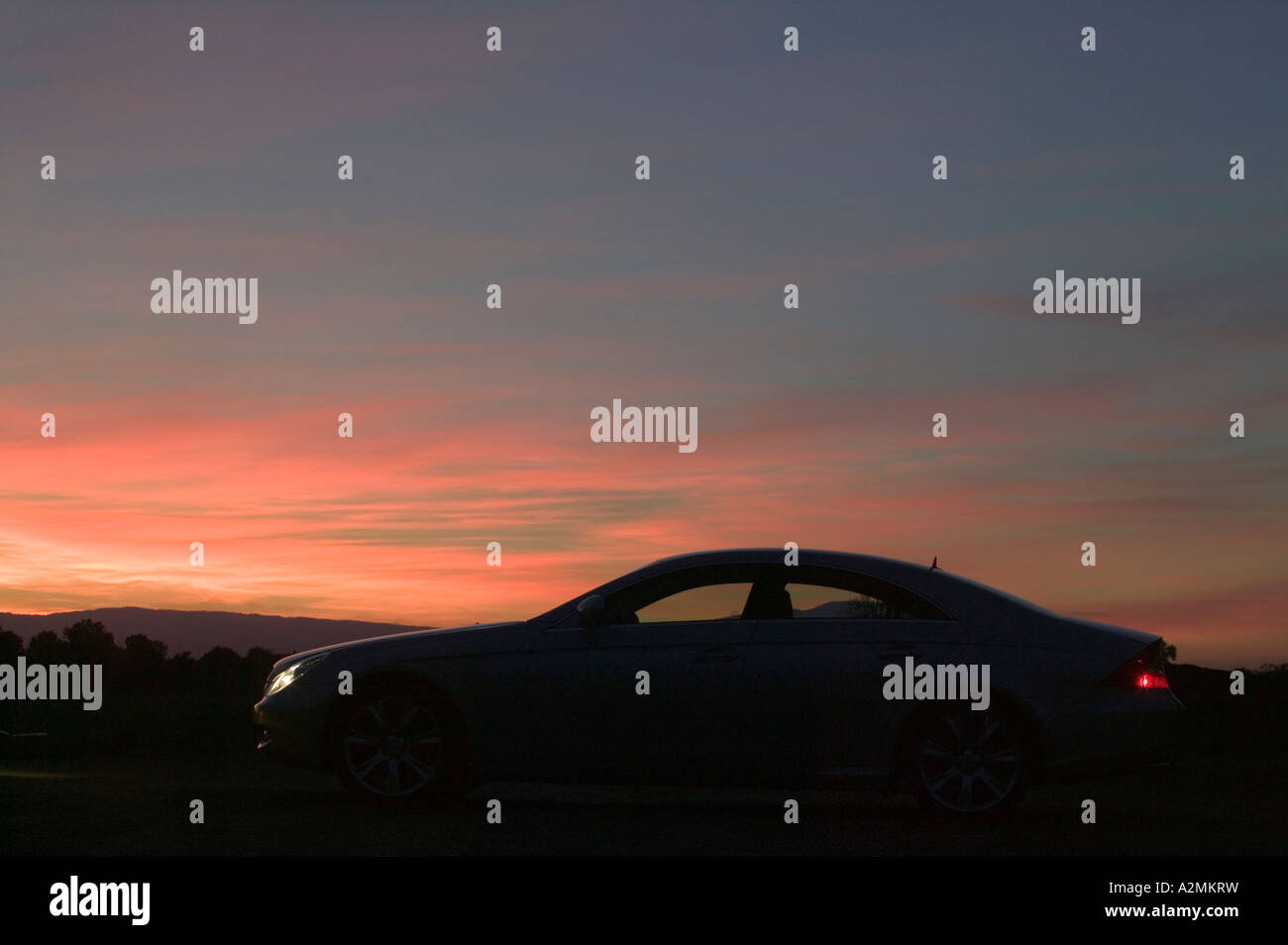 Car parked at sunset - Stock Image