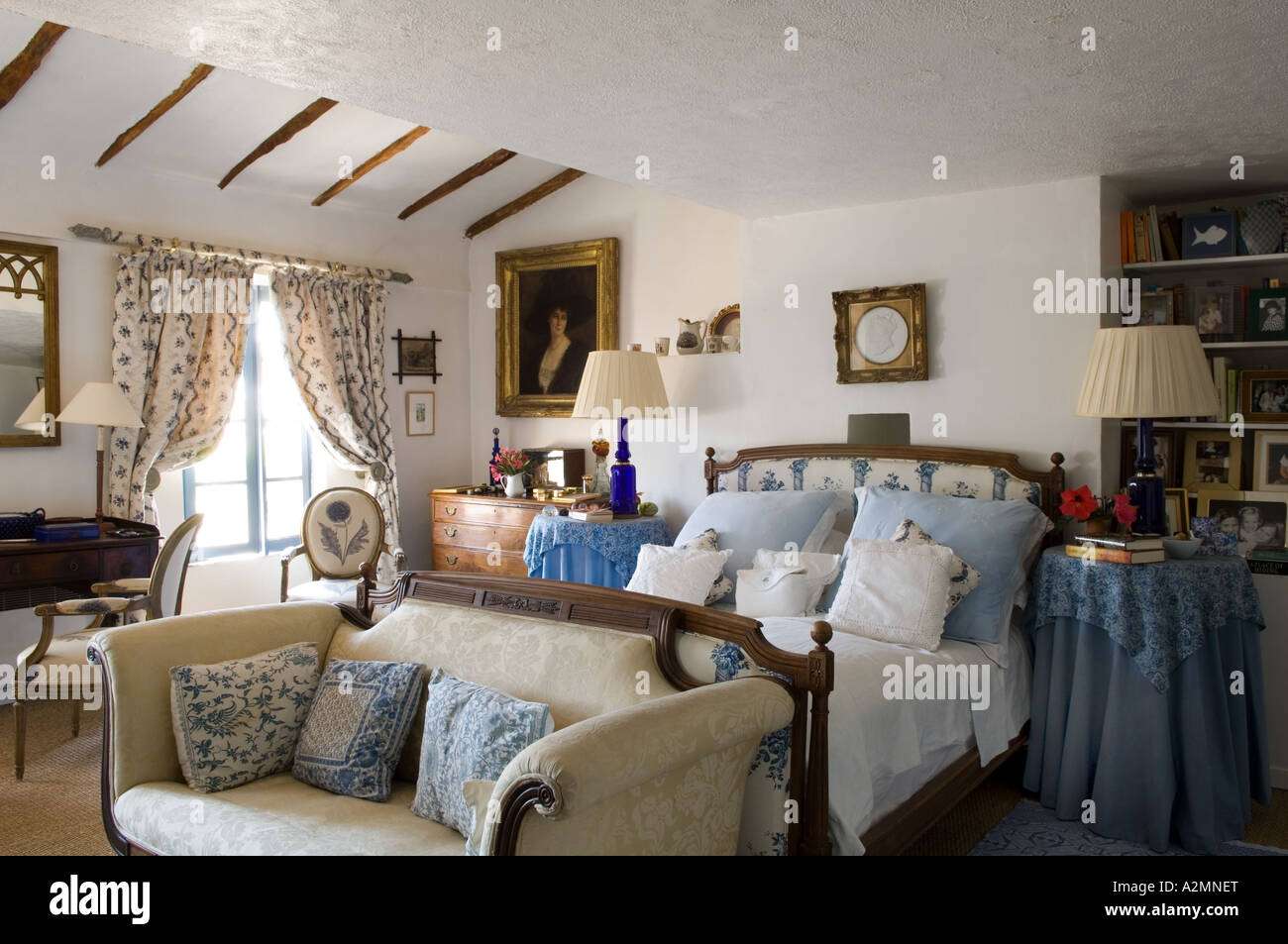 Traditional French country bedroom with sofa in Provençal house Stock Photo